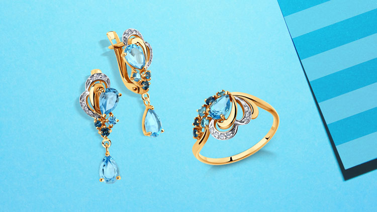 Комплект золотых украшений с топазами